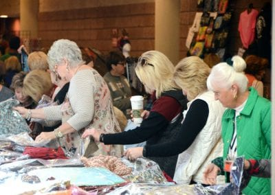 Line of women shopping for fabrics at the Norton trade show