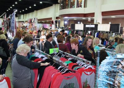 Retail store owners wholesale shopping for holiday shirts